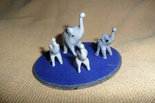 A great small collection of four glass Murano grey Elephants + a mirror base