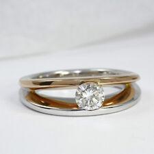 Designer Ring mit eingespanntem Brillant 0,58 Carat, 585 Weiss- Rotgold