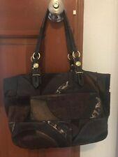 Brown signature patchwork Coach handbag with scarlet liner