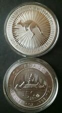 Two 1oz Silver Coins in Capsules