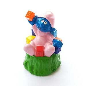 Smurf PVC Hollow Bip Holland 1999 Baby Plays With Cubes 3 1/8in