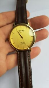 Omax Watch For Men Analog . Leather Brown. Gold