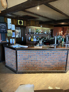 Home bar Reclaimed/ Man cave pub with solid hardwood top counter.