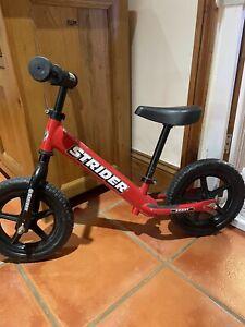 Red Strider balance bike 12 Inch