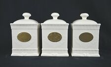 SET OF THREE CERAMIC TEA/SUGAR/COFFEE CANISTER SET BRASS/WHITE