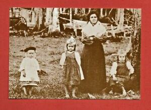 Australian PIONEER FAMILY postcard wood clothes hat wagon hut children mother