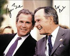 GEORGE W. BUSH - PHOTOGRAPH SIGNED CO-SIGNED BY: GEORGE H.W. BUSH