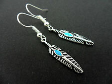 A PAIR OF  TIBETAN SILVER DROP DANGLY  FEATHER  EARRINGS. NEW.