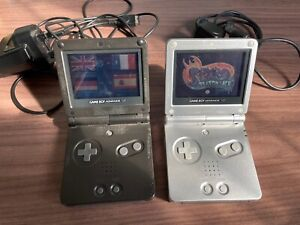 2 x GameBoy Advance SP Consoles - Black & Silver + 2 games, charger, link lead