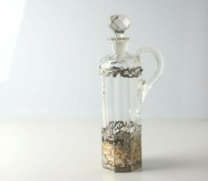 Late 19th Century Dutch Gilt 830 Silver mounted cut crystal cruet / decanter