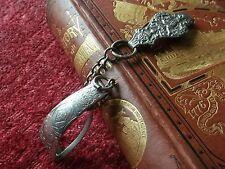"Victorian ""Wright Eureka""chrome skirt lifter belt clip and chain."