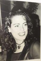 Vintage photo w/ a lady smiling