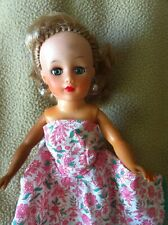 Uneeda Miss Suzette Doll,10in.floral dress, green eyes, red nail polish,earrings