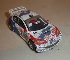 SCALEXTRIC SCX PEUGEOT 206 WRC MUNIENTE-PUJOL, MUD EFFECT    (CH)