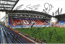 A 12 x 8 inch photo featuring DW Stadium, personally signed by 17 Wigan players.