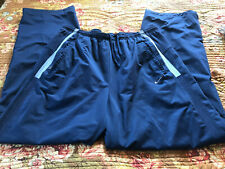 blue lined NIKE DRI-FIT athletic pants size XL
