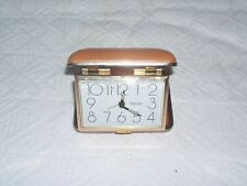 Vintage Mechanical Watch With an Alarm Clocks in a tan travel Box parts.