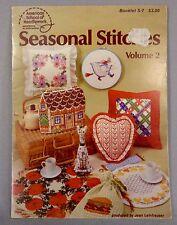 Seasonal Stitches cross stitch pattern book holidays gingerbread house witch cat