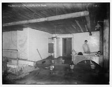 Photo:Bowery: 10 cent Turkish Bath,man bathing other man laying on table