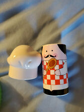 Chef with toque hat salt and pepper shakers