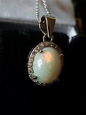 Opal Pendant beautiful fiery blues greens red pink 925 white topaz