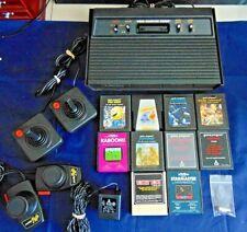 Atari 2600 Console/Game Lot Vader Console Joysticks Paddles 10 Games Q-Bert More