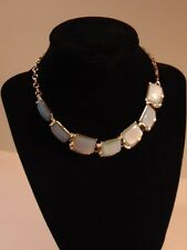 Silver colored chain necklace with bluish gray rectangular jewels