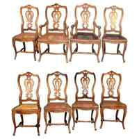 Eight Italian Renaissance Revival Carved Fruitwood and Caned Dining Chairs