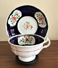 Gaudy Welsh Columbine pattern cup & saucer with display stand