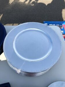 silver and navy blue beaded charger plates