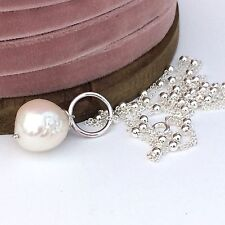 Long sterling silver decorative necklace with large freshwater pearl