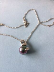 Iridescent Pearl WIth Crystals Of Cubic Zircon On A Silver Chain