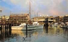 Picturesque Fisherman's Wharf, cloudy day, fishing fleet, boats bateaux