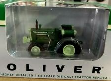NEW 1/64 Oliver 1955 tractor w/ front assist, very nice. New in box. Spec Cast