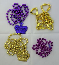 "set of 4 mardi gras beads 16"" long with crown pendant facted gold and purple"