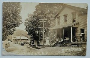 c1907-1915 RPPC Postcard Chadwicks, NY Gen Store Signs Early Motorcycle Harley?