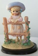 Figurine Barefooted Girl Child with hat Leaning on Fence decorated with flowers