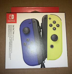 NINTENDO SWITCH PAIR OF JOY CON - PAI BLUE / NEON YELLOW - BRAND NEW CONTROLLERS