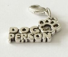 SILVER DOG PERSON WITH A PAW PRINT ON IT  CLIP ON CHARM  - TIBETIAN SILVER - NEW