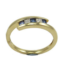 14ct GOLD MODERN CROSSOVER STYLE PRINCES BLUE SAPPHIRE AND DIAMOND ETERNITY RING