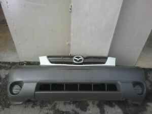 Front Bumper DX-V6 Without Fog Lamps Fits 01-04 MAZDA TRIBUTE 24356