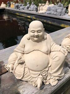 Garden concrete statue laughing Buddha