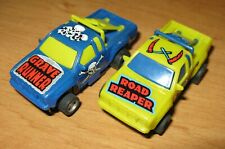 TYCO ROAD REAPER GRAVE RUNNER  PAIR HO SLOT CAR  VERY GOOD COND.