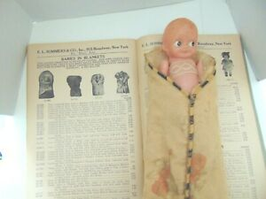 Antique Celluloid Baby In Bunting. All original.  Pictured in  1927-28 Trade cat