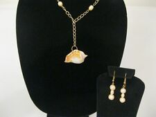 Sea Shell Pendant on a gold chain with fresh water Pearls and dangle earrings.
