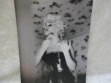 Black & White Photo of Marilyn Monroe Applying Make-Up/Powder Puff