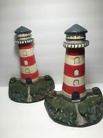 PAIR OF VINTAGE TALL CAST IRON LIGHTHOUSE BOOKENDS/DOORSTOPS   12'' TALL