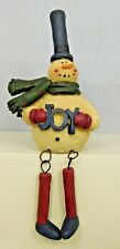 Sitting snowman with dangling legs and sign with Joy - New Blossom Bucket#80590A