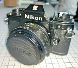 Nikon EM with 50mm f1.8 Series E - late, silver-button model with manuals, 1980s