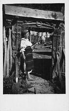 Romania 1930s Stramtura Maramures County,Woman in folk costume,wooden gate